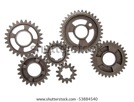 Heavy metal gears linked together on white background. - stock photo