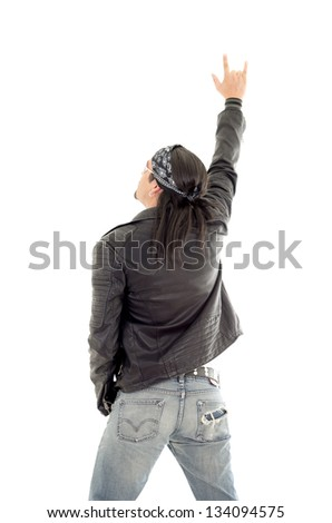 heavy metal guitarist making a rock and roll gesture - stock photo