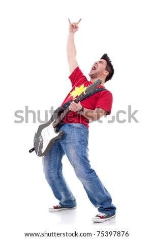 heavy metal guitarist making a rock and roll gesture while screaming and playing - stock photo