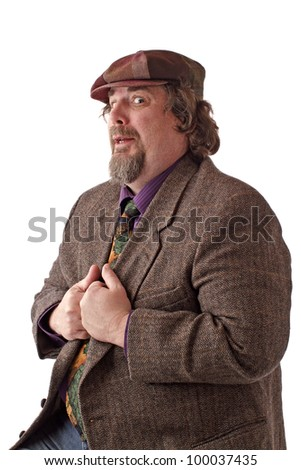 Heavy middle-aged man with goatee, cap and tweed jacket has hands gripping lapels. Horizontal, isolated on white, copy space. - stock photo