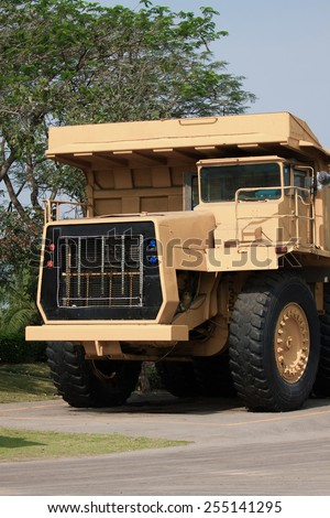 Heavy mining truck in mine and driving along the opencast. Photo of the big mine truck, The career heavy-load super car. - stock photo