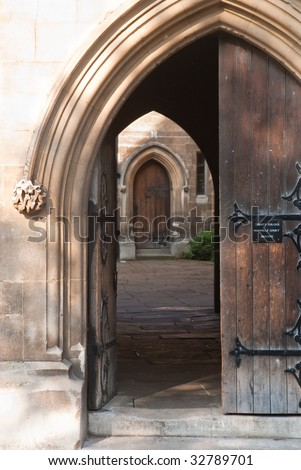 Heavy ornamented doorway leading to a gloomy patio - stock photo
