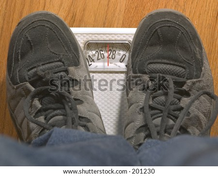 Heavy person on a scale. - stock photo
