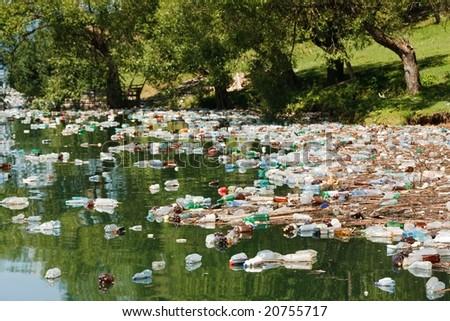 heavy plastic pollution in wild beautiful landscape - stock photo