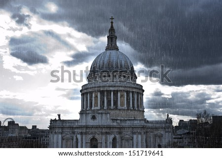 Heavy rain over St. Paul's Cathedral in London - stock photo