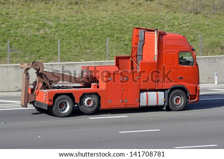 Heavy recovery breakdown tow truck on M25 London orbital motorway in Essex England UK - stock photo
