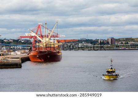 Heavy red tanker at port in Saint John, New Brunswick, Canada - stock photo
