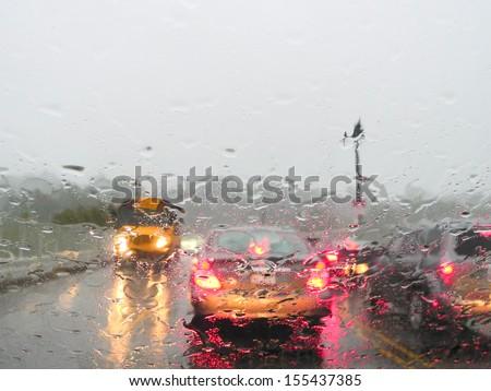 Heavy rush hour traffic in the rain - stock photo