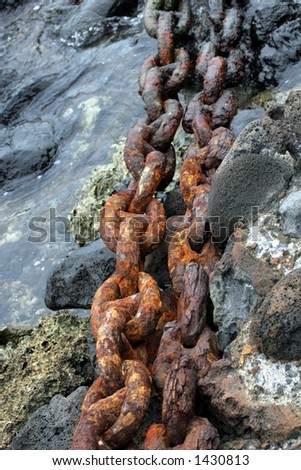 Heavy rusty chain in the water. - stock photo