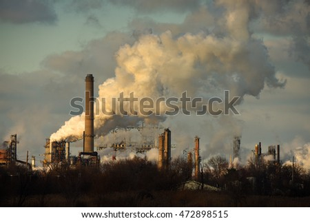 Heavy smoke being released from smokestacks in late afternoon