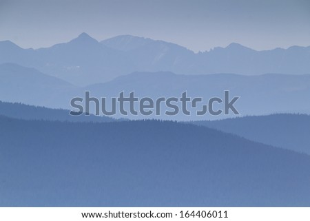 Heavy smoke from forest fires near Vail Colorado obscures the distant mountain views on this fall morning. - stock photo