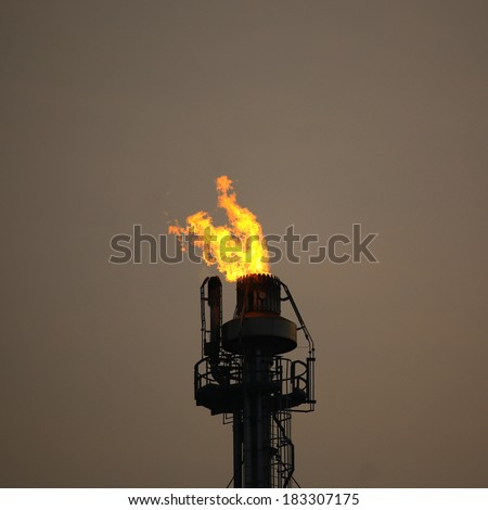 Heavy smoke from industrial chimney polluting the environment at night - stock photo