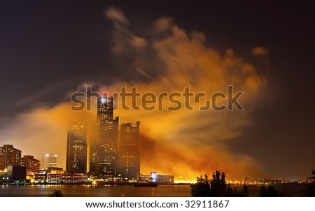 Heavy smoke over the Detroit skyline right after the fireworks ended. - stock photo