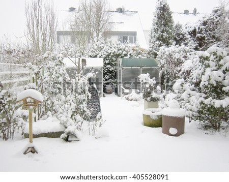 Heavy snow covered the garden in the backyard, winter , Exterior view,  Germany, Europe, December to February - stock photo