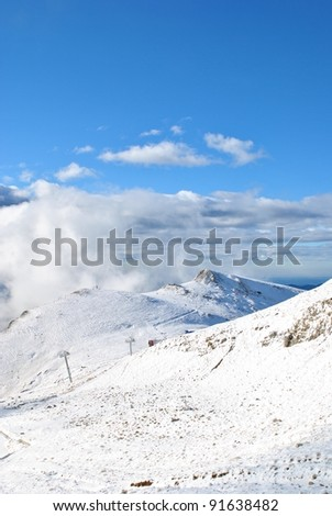 Heavy snow fall over the tall mountains