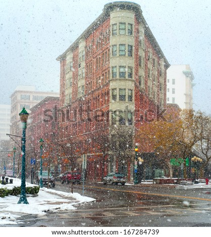 Heavy snow falls on the streets of downtown Syracuse New York - stock photo