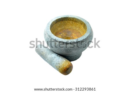 Heavy stone pestle and mortar over a white background - stock photo