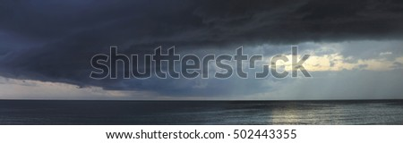 Heavy storm with dark clouds abow the ocean