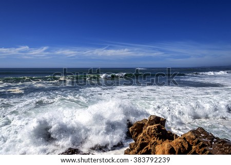 Heavy surf / waves, rock and geological formations along the rugged Big Sur coastline, near Monterey, CA. on the California Central Coast. - stock photo