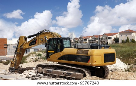 Heavy Tractor during a road construction work - stock photo