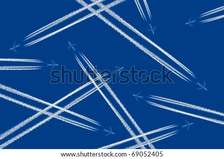 Heavy traffic: airliners criss-crossing the blue sky. - stock photo