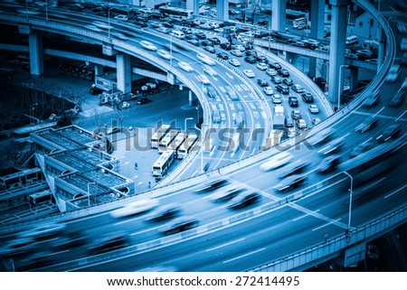 heavy traffic closeup , vehicles motion blur on viaduct with blue tone