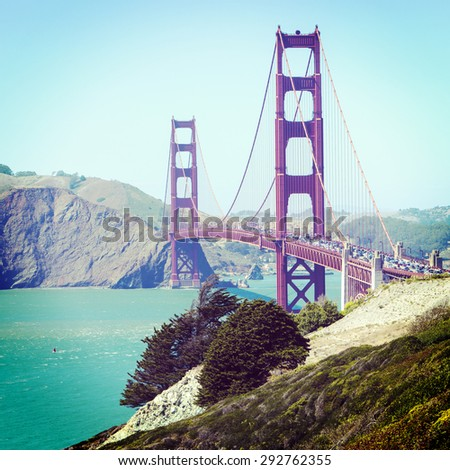 Heavy traffic crossing the Golden Gate Bridge in San Francisco with Instagram effect filter - stock photo