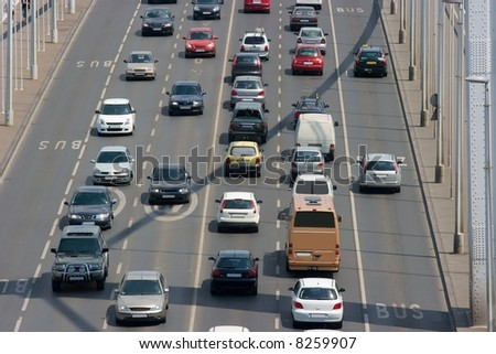 Heavy traffic on a main road over a bridge