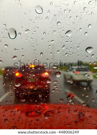 Heavy traffic on an interstate during a rainstorm