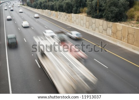 Heavy traffic with motion blur - stock photo