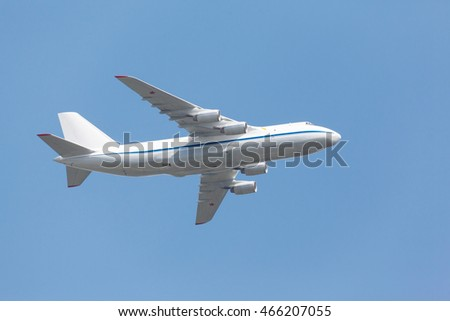 heavy transport aircraft takes off from the runway on the background of blue sky