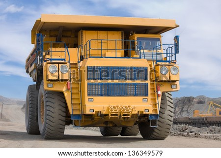 Heavy Truck RIdes with Ore - stock photo