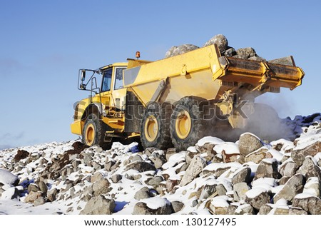 heavy trucking, rough and snowy terrain driving, close-ups - stock photo