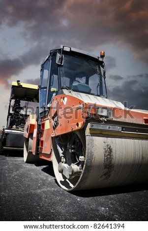 Heavy Vibration roller at asphalt pavement works (road repairing) - stock photo