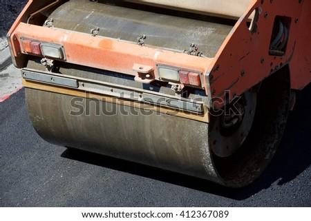 Heavy Vibration roller in asphalt pavement work. - stock photo