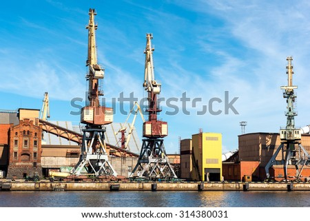 Heavy weight cranes lifting coal from trains - stock photo