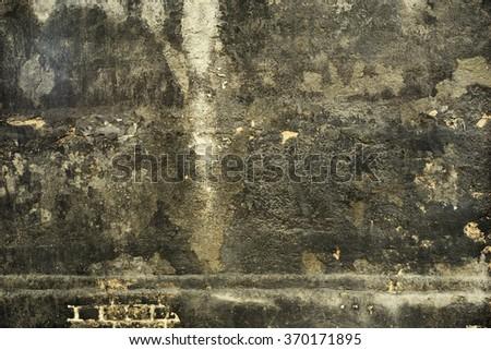 Heavy worn grey black building wall. Vintage effect.  - stock photo