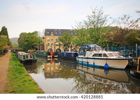 HEBDEN BRIDGE, UK - MAY 11, 2016: Canal boats of the Rochdale Canal, Hebden Bridge. Hebden Bridge is a market town in the Upper Calder Valley, West Yorkshire - stock photo