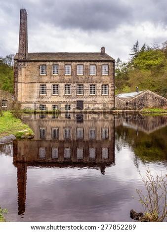 Hebden Bridge, West Yorkshire, UK. 10th May 2015. Gibsons Mill and Mill Pond, Hebden Bridge, West Yorkshire, UK - stock photo