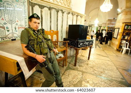 HEBRON, OCCUPIED PALESTINIAN TERRITORIES - OCTOBER 17: An Israeli soldier guards the Tomb of the Patriarchs on Oct. 17, 2010. The newly named UNESCO site is split between a mosque and a synagogue.