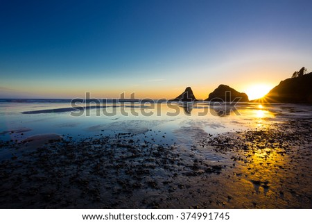 Heceta Head Beach located on the beautiful Oregon Coast at sunset on a clear Summer evening near dusk. - stock photo
