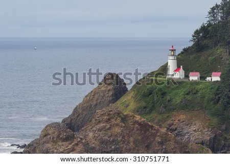 Heceta head lighthouse on a cloudy afternoon typical of the Oregon coast - stock photo