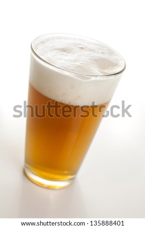 Hefeweisen beer in a pint glass - stock photo