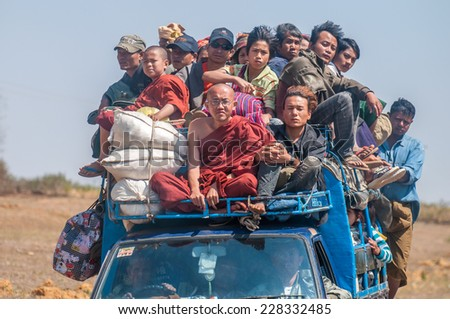 Heho,Myanmar-March 20,2011: Myanmar people on the light buses in Heho , Myanmar.They are used as a taxi because people can't effort their own transportation. - stock photo