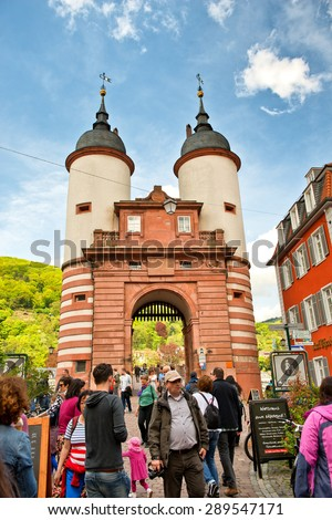 HEIDELBERG, GERMANY - APRIL 26: Throngs of Tourists Gathered Around Old Bridge Gate, a Popular Tourist Destination in Heidelberg, Baden-Wurttemberg, Germany on April 26, 2015 - stock photo