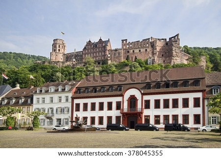 Heidelberg, Germany - April 30, 2014: View of the ruins of the castle of Heidelberg from a town square with people making pictures in Heidelberg, Germany on April 30, 2014