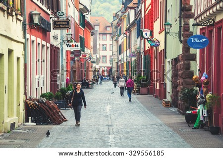 HEIDELBERG, GERMANY - MARCH 31, 2014: Unidentified people at the streets of famous touristic city. Various cafes, restaurants and shops.