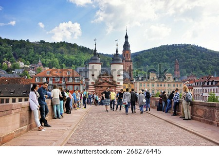 HEIDELBERG, GERMANY - MAY 5, 2013: Old bridge over the river to the city gate in summer european city of Heidelberg