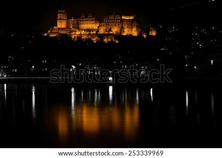 heidelberg's castle reflecting in the river  - stock photo