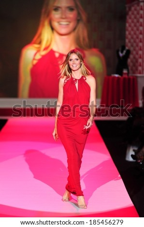 Heidi Klum, in a John Galliano gown, attending The Heart Truth's Red Dress Collection 2010 Fashion Show, Bryant Park, New York February 11, 2010 - stock photo